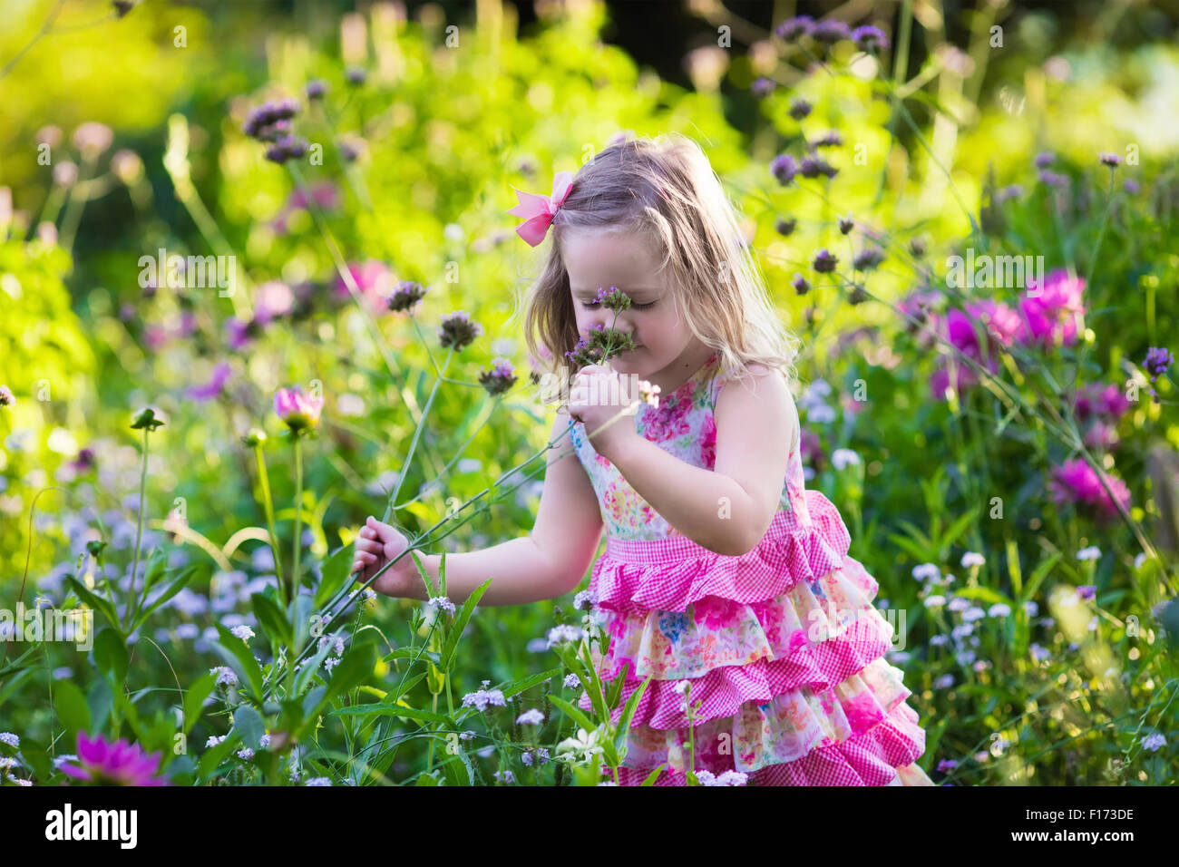 Little girl playing with flowers in the garden kids play outdoors little girl playing with flowers in the garden kids play outdoors in summer children gardening child planting flower mightylinksfo
