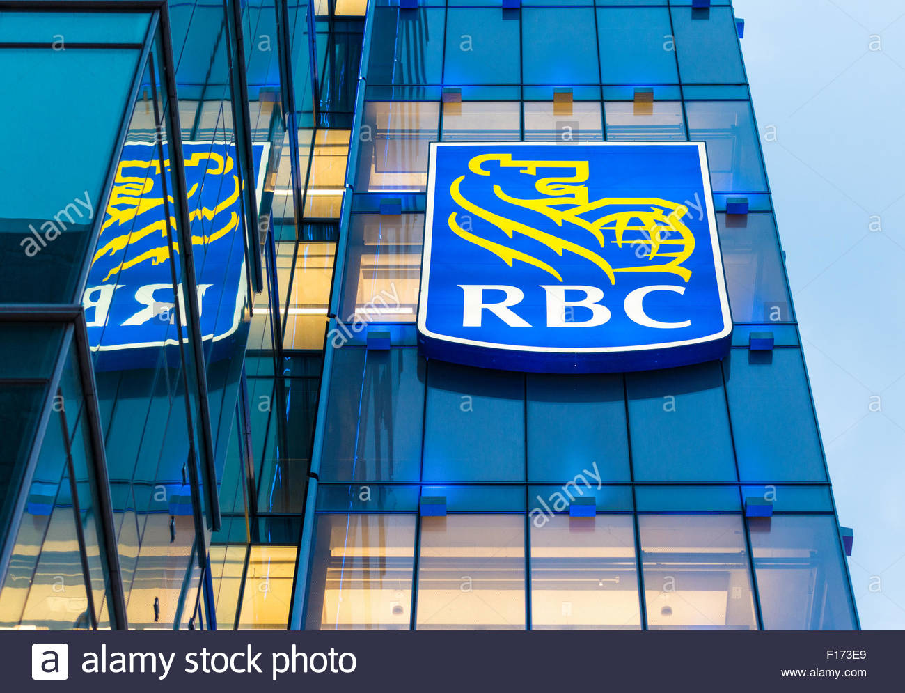 Royal Bank of Canada signage on a glass facade building. The signage has the outline of a lion holding a globe in - Stock Image