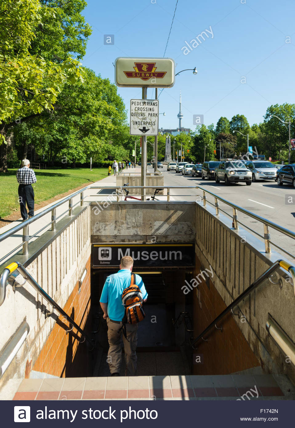 Toronto everyday scenes: Man walking down the stairs of the underpass leading to the Museum subway station. Museum - Stock Image