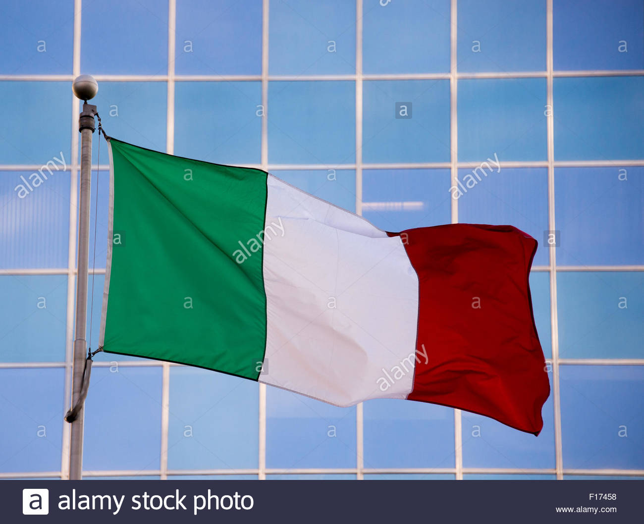 National flag of Italy. It is a tricolor featuring three equally sized vertical pales of green, white, and red, Stock Photo