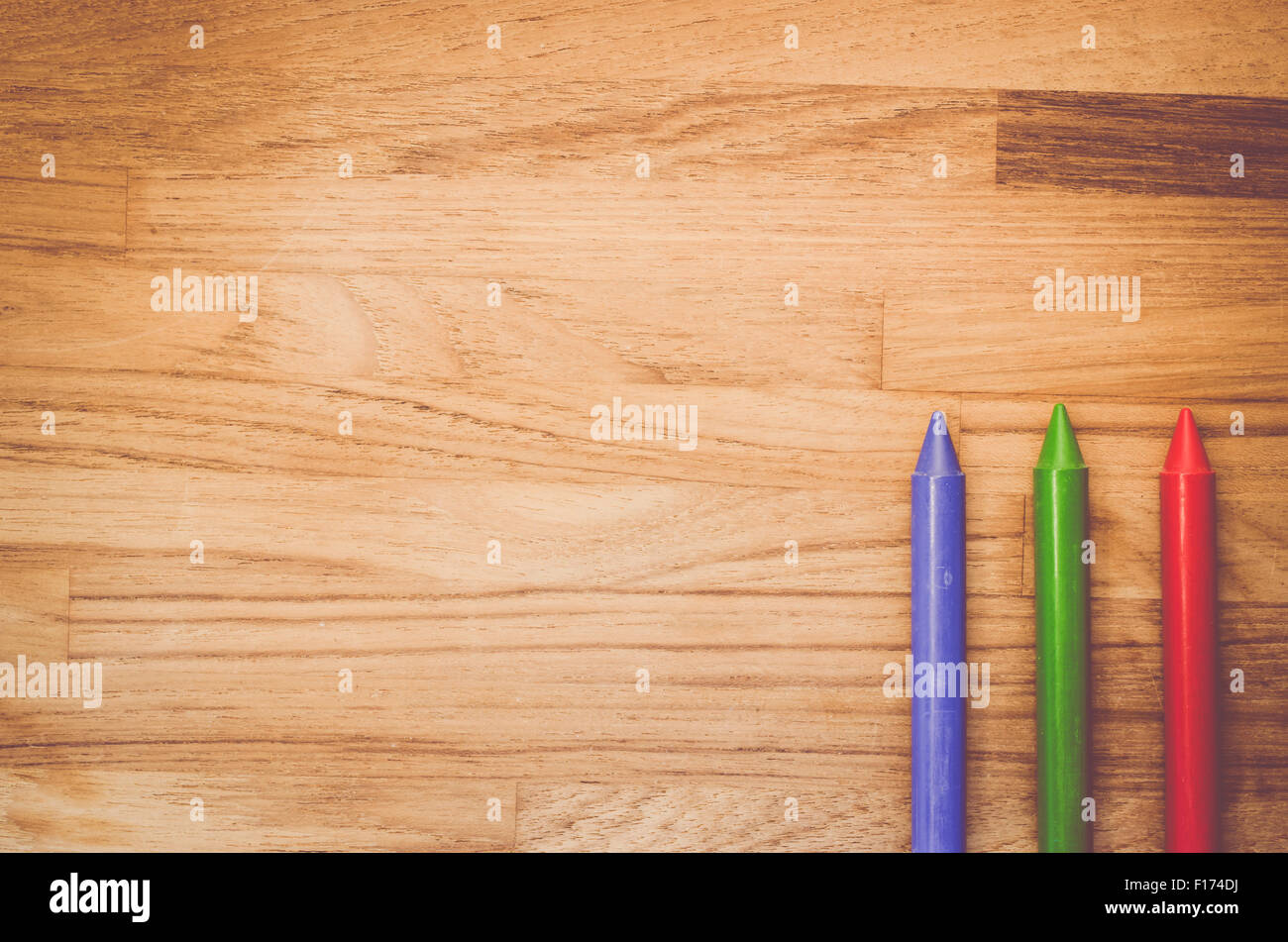 red green blue colored wax crayons on a natural wood. Black Bedroom Furniture Sets. Home Design Ideas