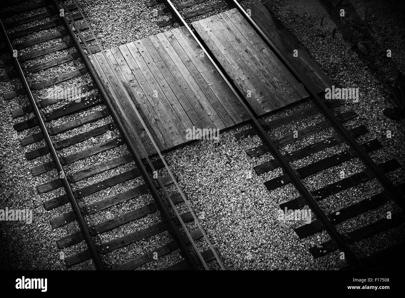 Railroad Tracks Closeup From Above. Black and White Railroad Theme. - Stock Image