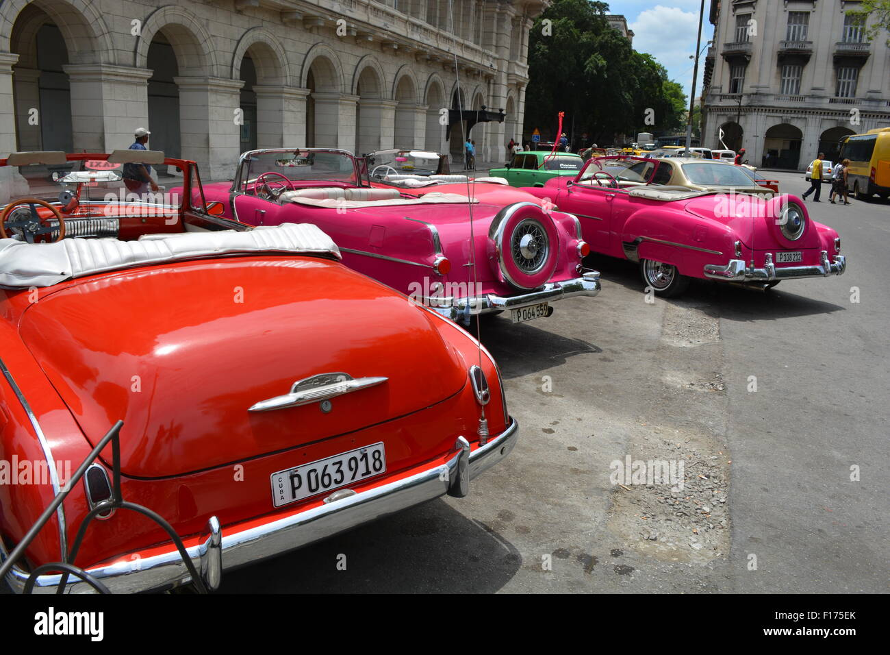 line of soft top vintage cars used for tourist taxi tours havana