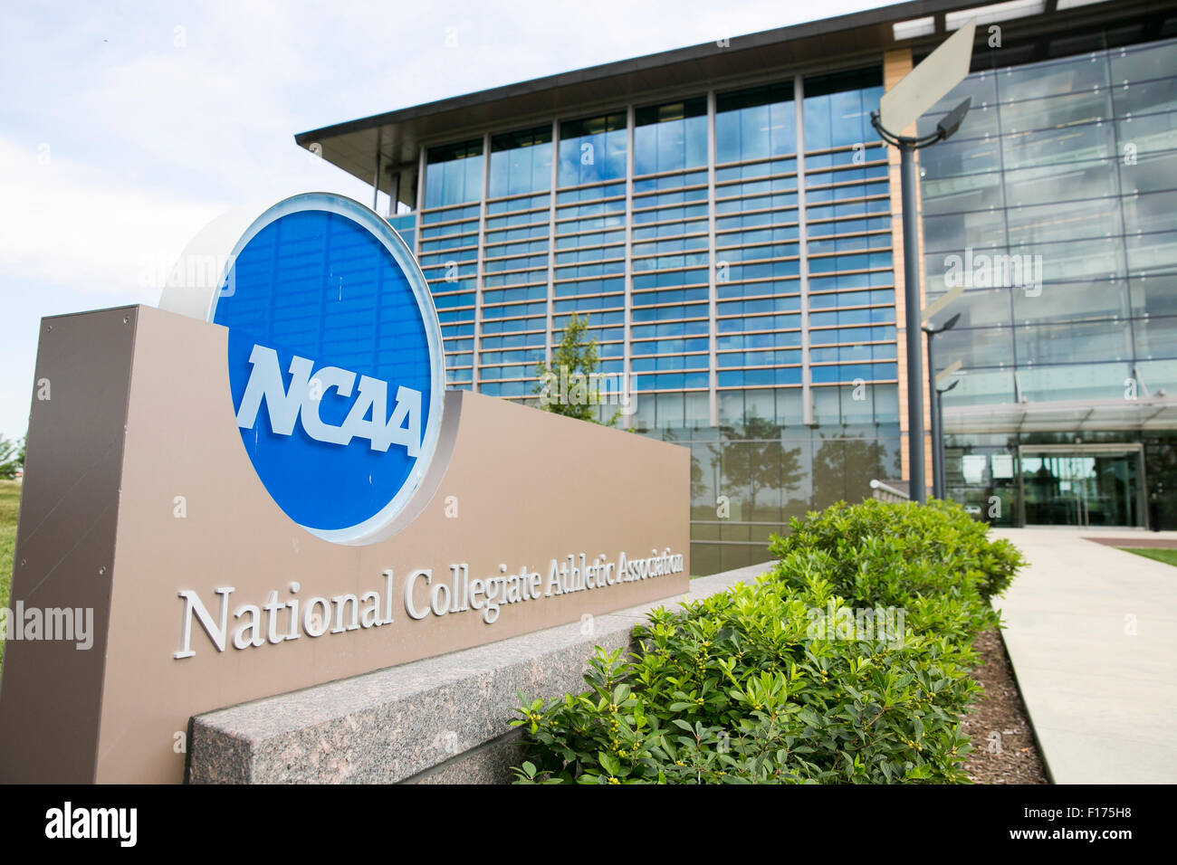 A logo sign outside of the headquarters of the National Collegiate Athletic Association (NCAA) in Indianapolis, - Stock Image