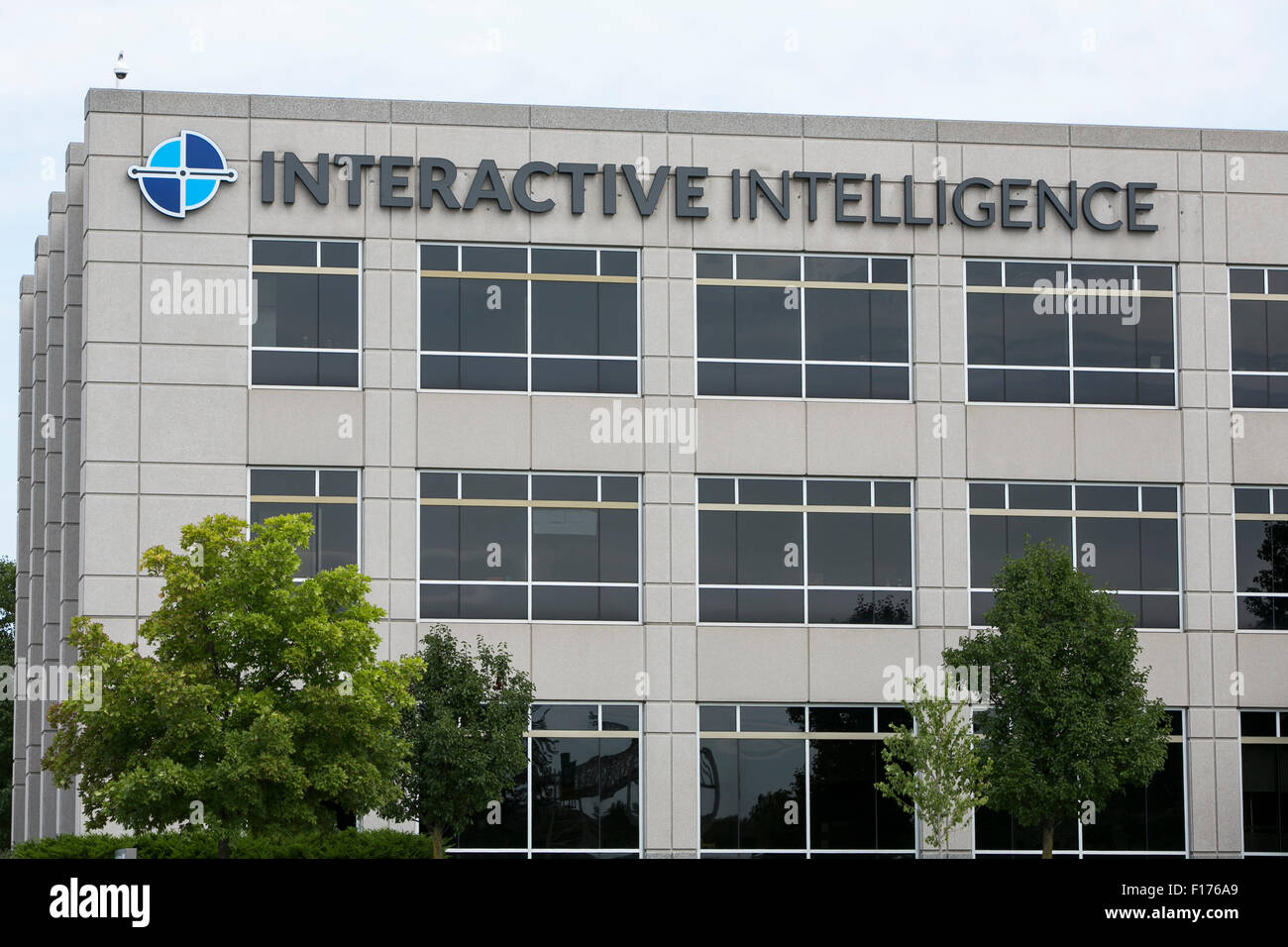 A logo sign outside of the headquarters of Interactive Intelligence, Inc., in Indianapolis, Indiana on August 15, - Stock Image
