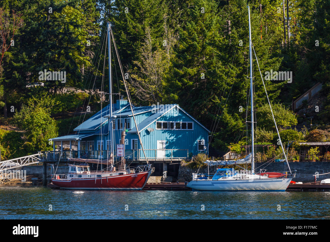 Two sailing vessels docked in Pender Harbour on the Sunshine Coast of British Columbia - Stock Image