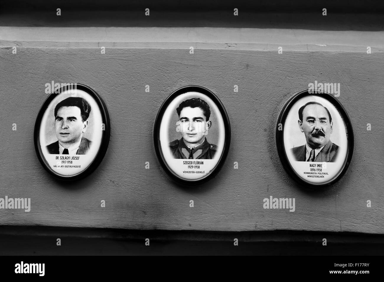 Photographs of people executed in 1956/1957 on the wall of the House of Terror, Andrassy Ut 60, Budapest, Hungary - Stock Image