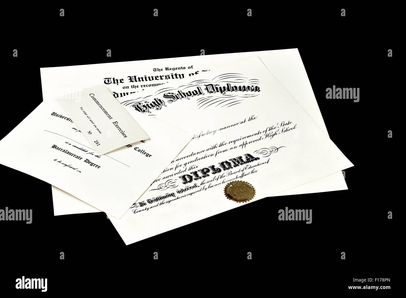 Education certification documents including high school diploma,commencement ticket, and university degree isolated - Stock Image