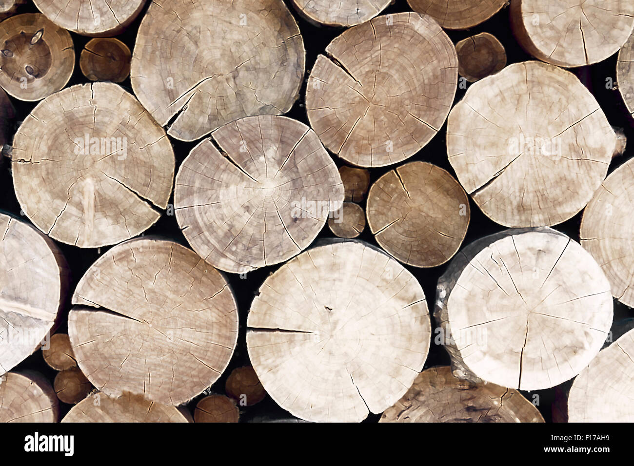Many large and thick cracked tree beams in a pile - Stock Image