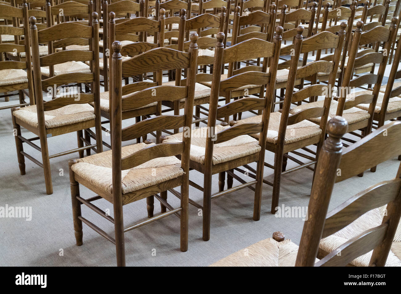 Empty church chairs in the Sint-Michielskerk in Ghend, Belgium - Stock Image