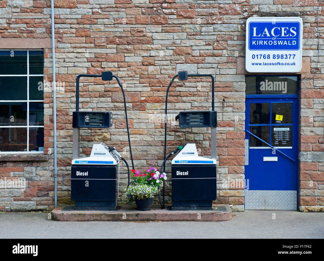 Two petrol pumps in the village of Kirkoswald, Eden Valley, Cumbria, England UK - Stock Image