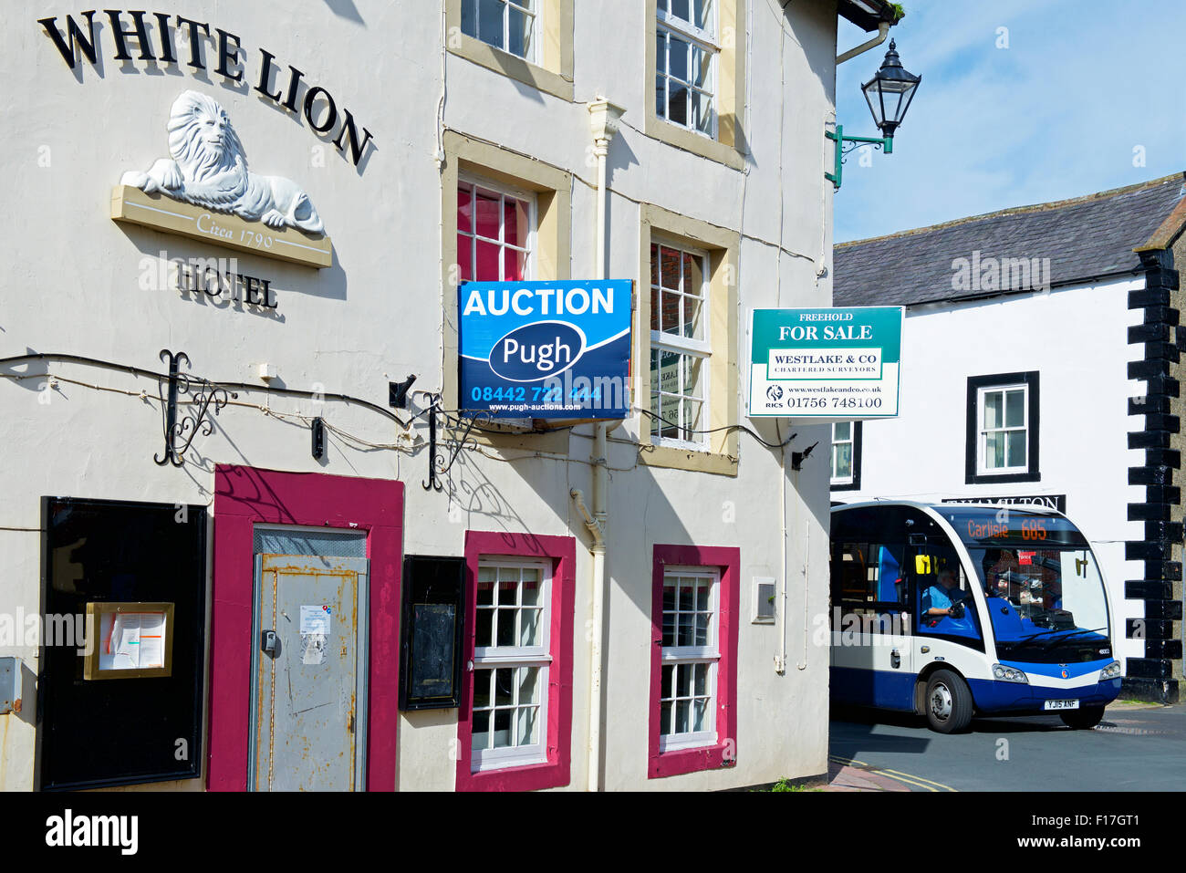 The White Lion pub, shut and shuttered, with For Sale sign, in Brampton, Cumbria, England UK - Stock Image
