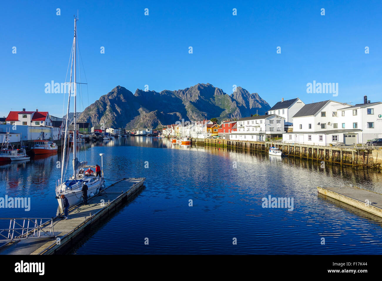 Henningsvaer village and blue sea Lofoten Islands Norway - Stock Image