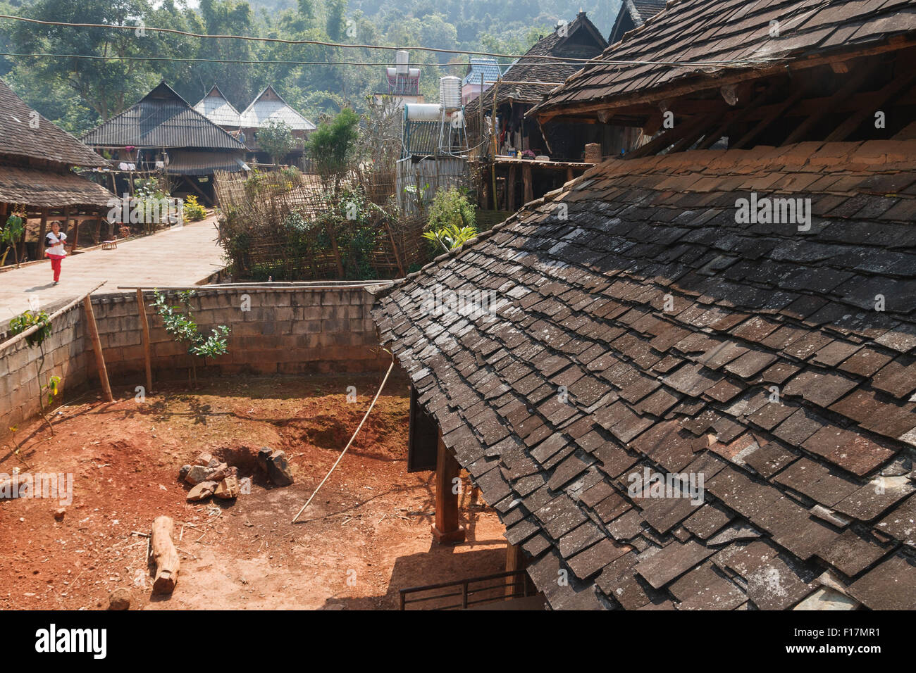 Looking out over roof of traditional hut in rural village in Xishuangbanna, Yunnan, China - Stock Image