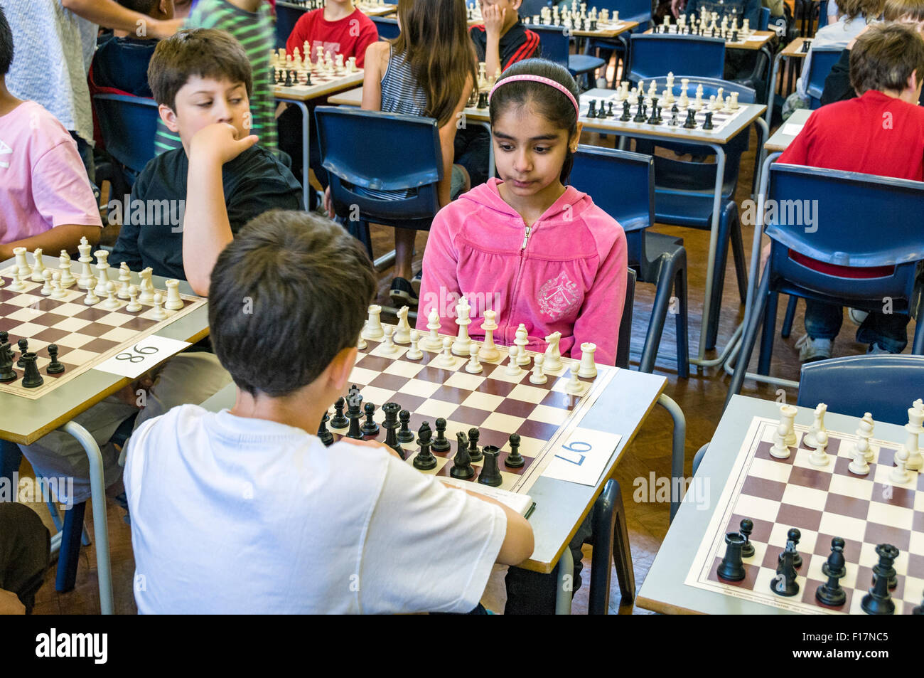 Contestants facing each other at chess tournament - Stock Image