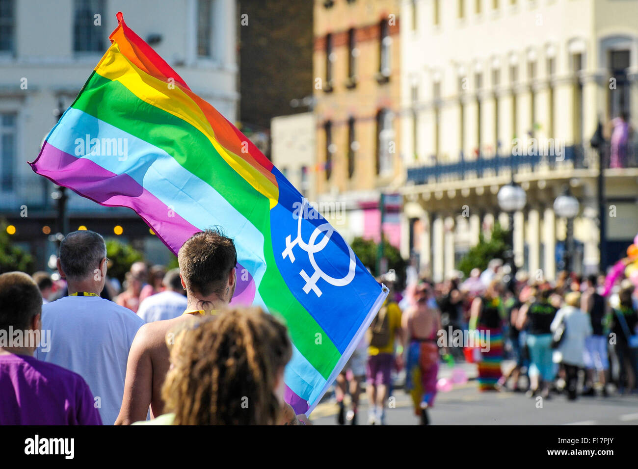 Margate, Kent, UK. 29th August, 2015. A large LGBTQ+ flag is proudly held aloft as thousands gather to lend their - Stock Image