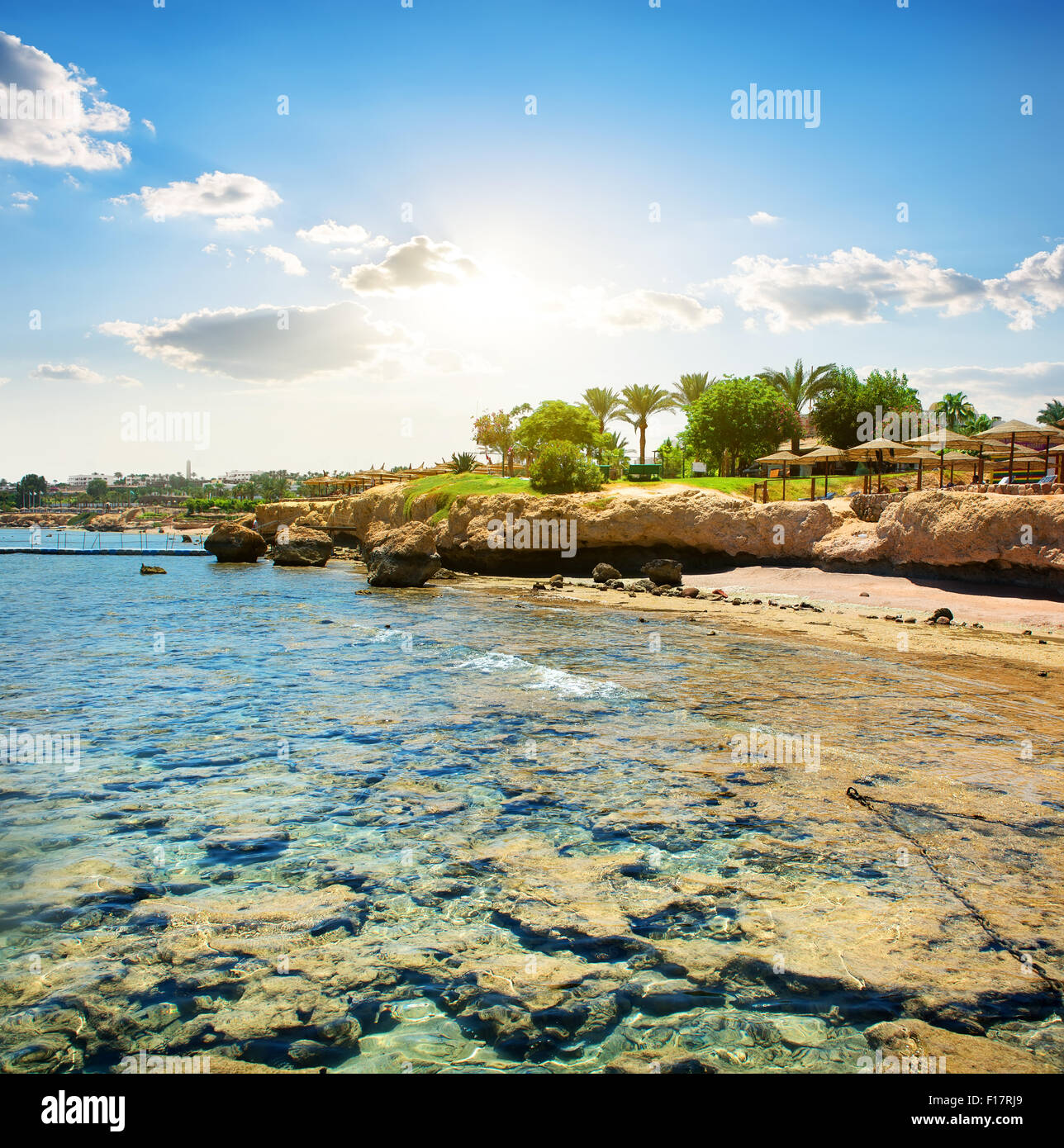 Coral reefs on the beach near hotel - Stock Image