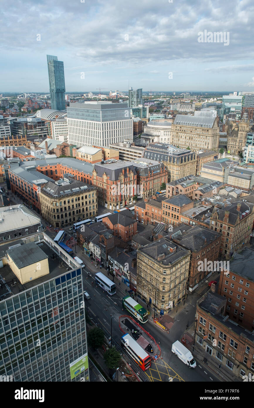High viewpoint above Portland Street Manchester City Centre and the Hilton Hotel Beetham Tower - Stock Image