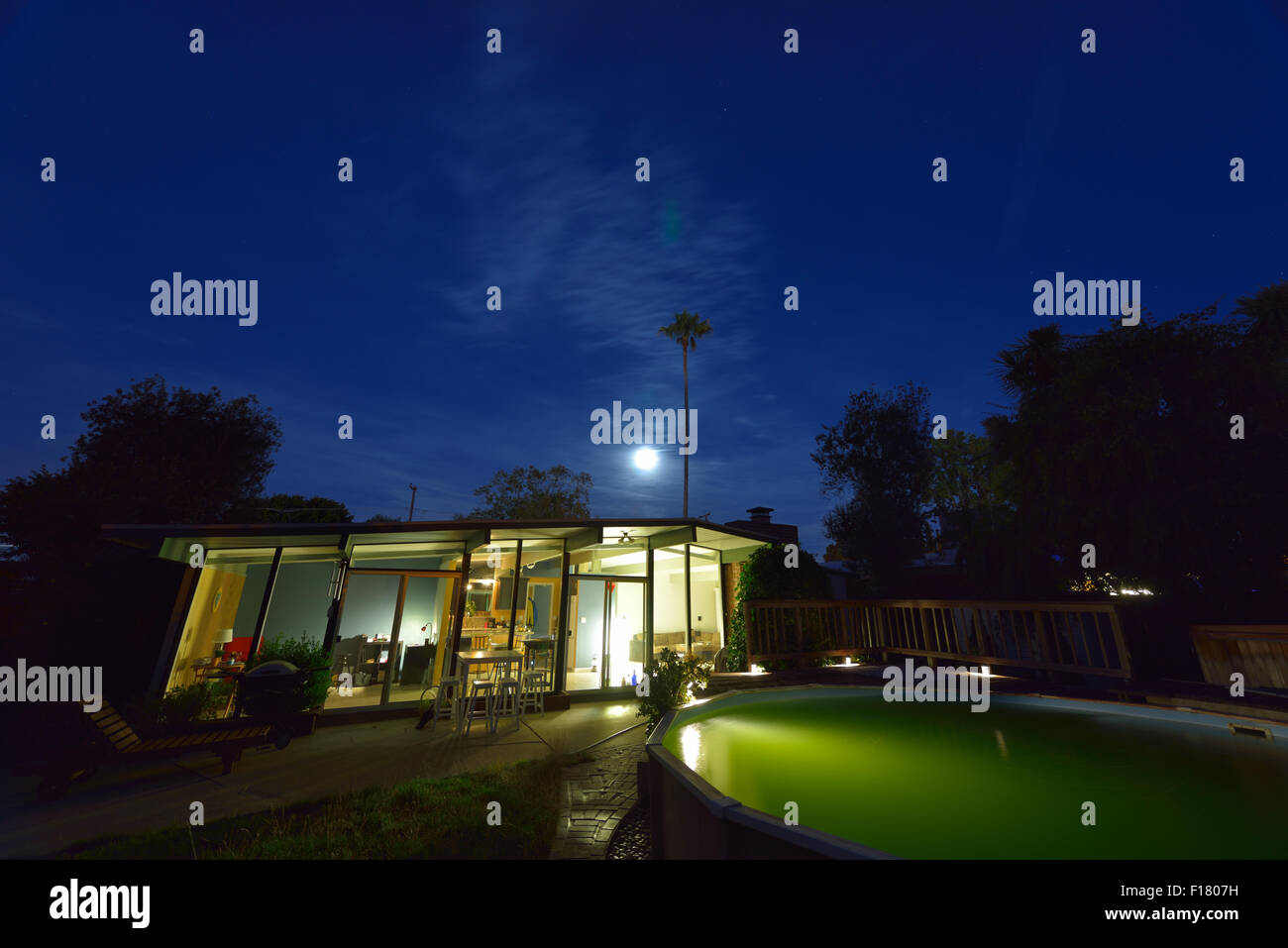 A traditional Eichler Home under a full moon, California CA - Stock Image