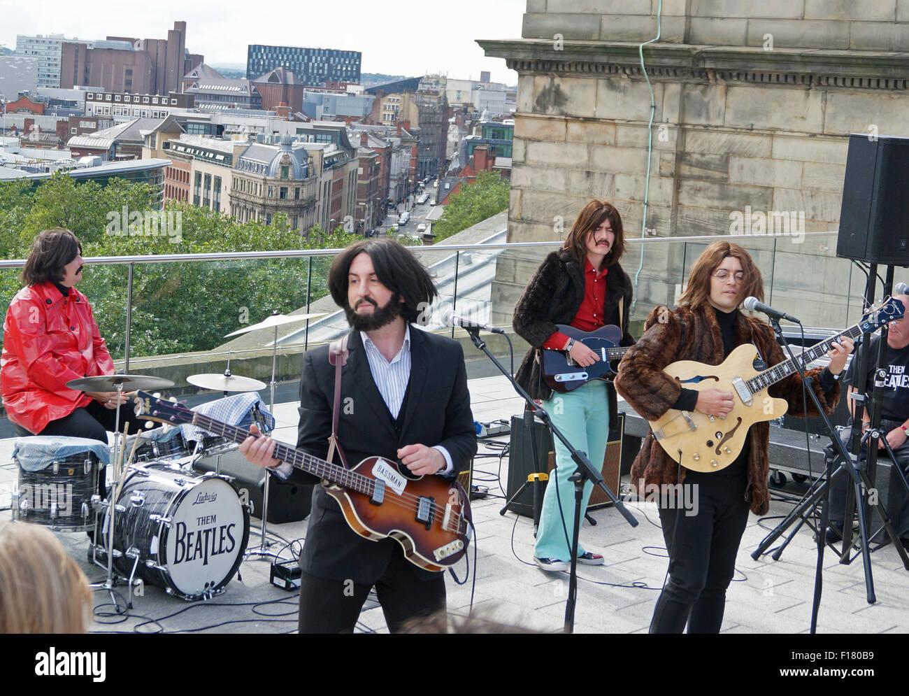 Liverpool, UK. 29th Aug, 2015. Them Beatles, a Scottish Beatles tribute band, recreated the Beatles last public - Stock Image