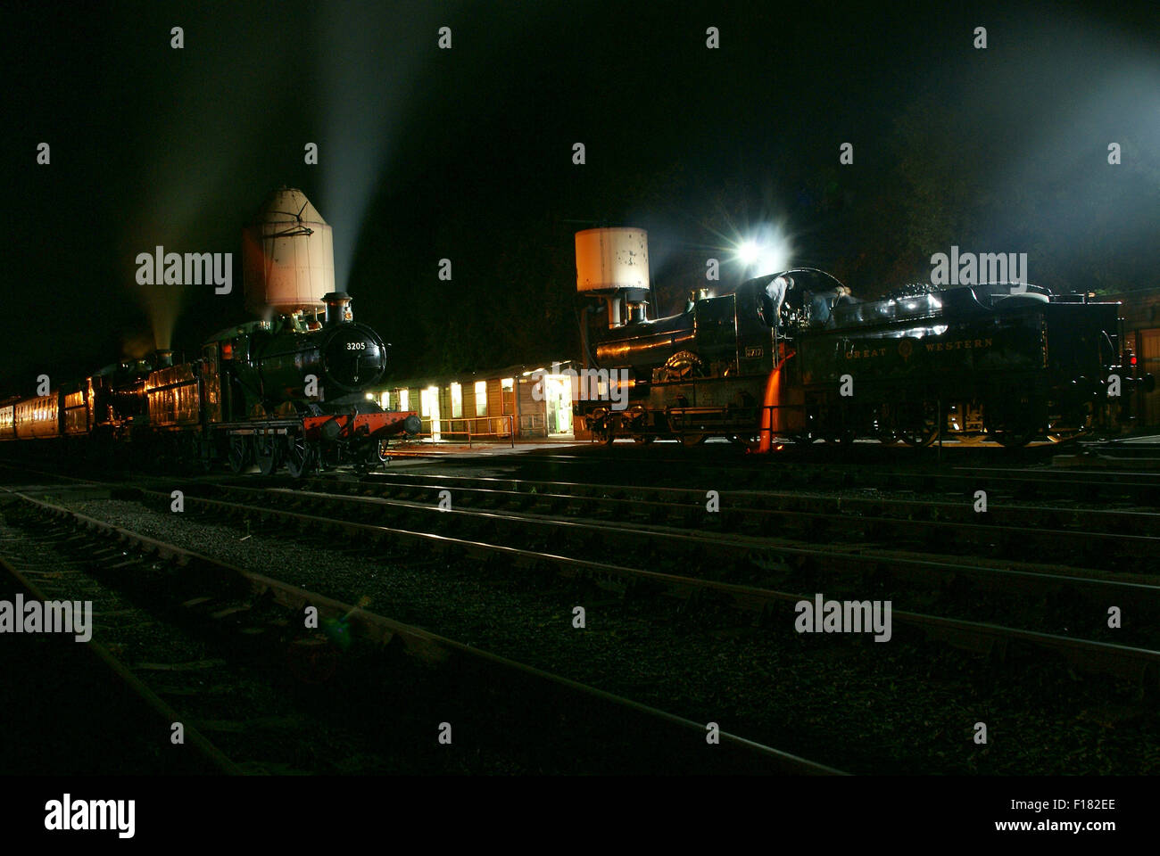 Night scene at Bewdley with GWR 3700 Class 3717 City of Truro and GWR 0-6-0 No 3205. City of Truro is emptying its - Stock Image