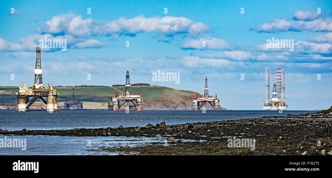 Oil drilling rigs anchored in the Cromarty Firth at the Black Isle Highland Scotland - Stock Image