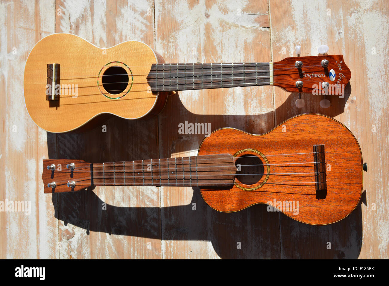Tanglewood 'Cove Creek' soprano ukulele Model TU2,  and a Liam Kirby 'Ike' soprano ukulele - Stock Image
