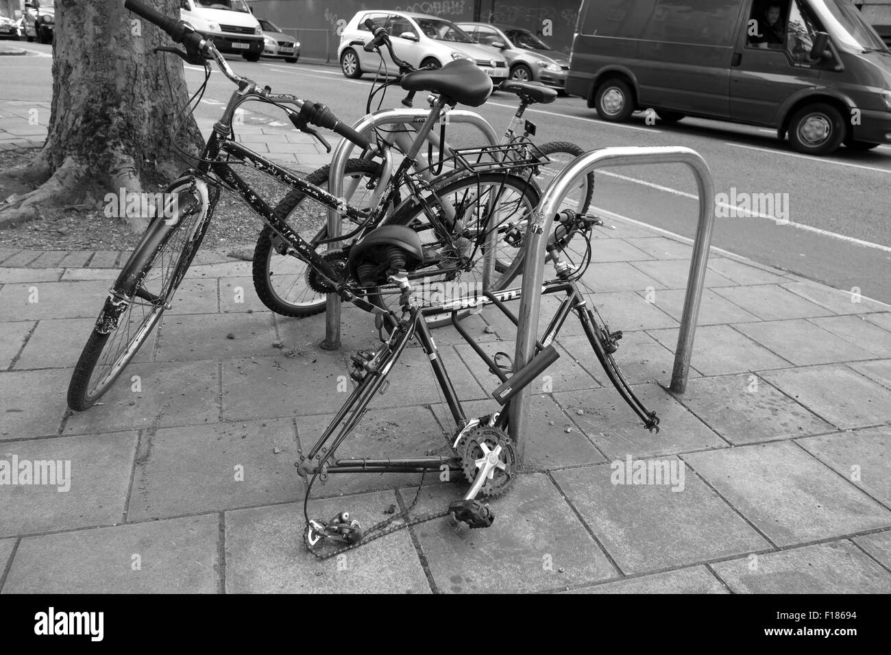 Remains of an old bike in Central Bristol after the wheels have been stolen, August 2015 - Stock Image