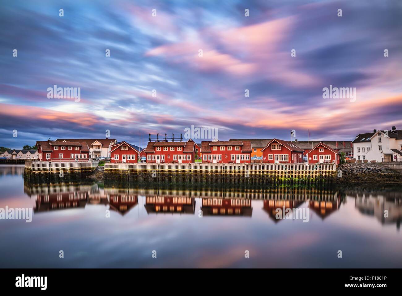 Sunset over harbor houses in Svolvaer. Svolvaer is located  in Nordland County on the island of Austvagoya in Lofoten, - Stock Image