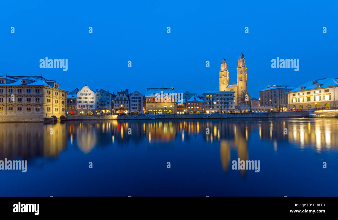 Zurich with the Grossmunster and the Limmat river at night - Stock Image