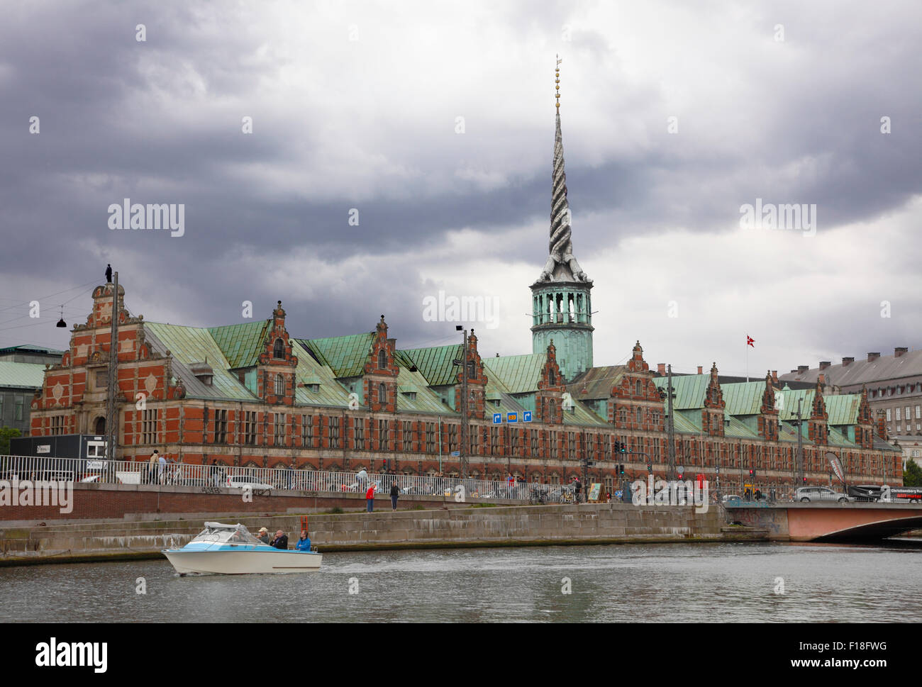 View of the Old Stock Exchange in renaissance style and tower of twisted dragon tails on a summer day with threatening - Stock Image
