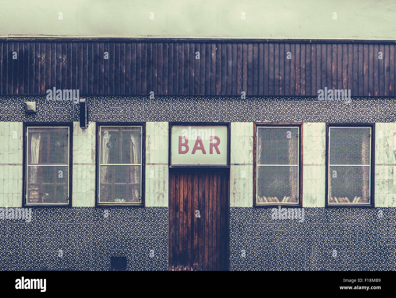 Retro Filtered Image Of A Grungy And Seedy Bar - Stock Image