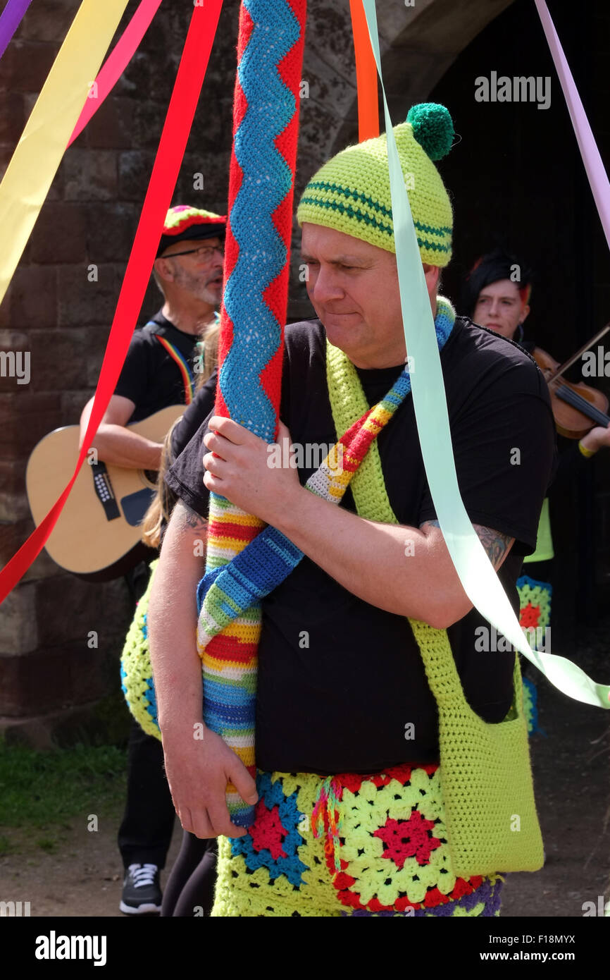 Gay man holding the Maypole while preparing for the Manchester Pride 2015 Big Parade through the City Centre - Stock Image