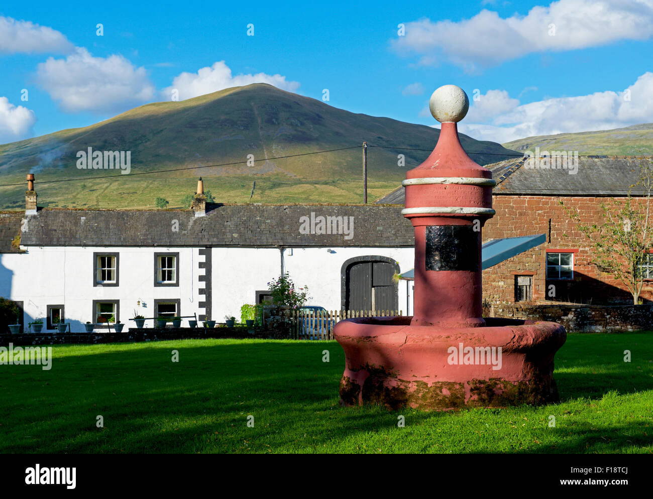 Water fountain on the green in the village of Dufton, with Dufton Pike behind, Eden Valley, Cumbria, England UK - Stock Image