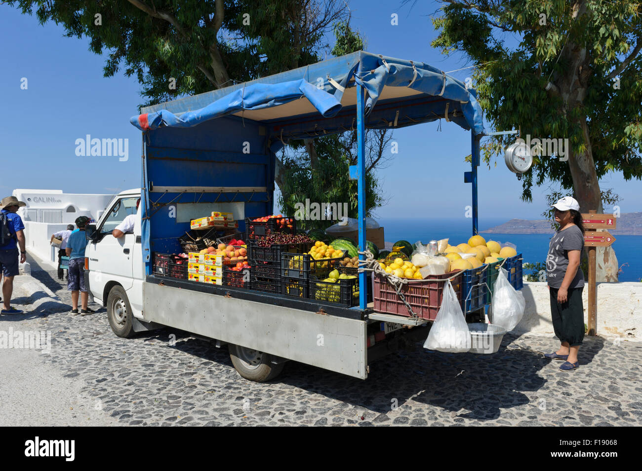 A mobile market at the back of a lorry selling fresh vegetables and fruits, Santorini, Greece. Stock Photo