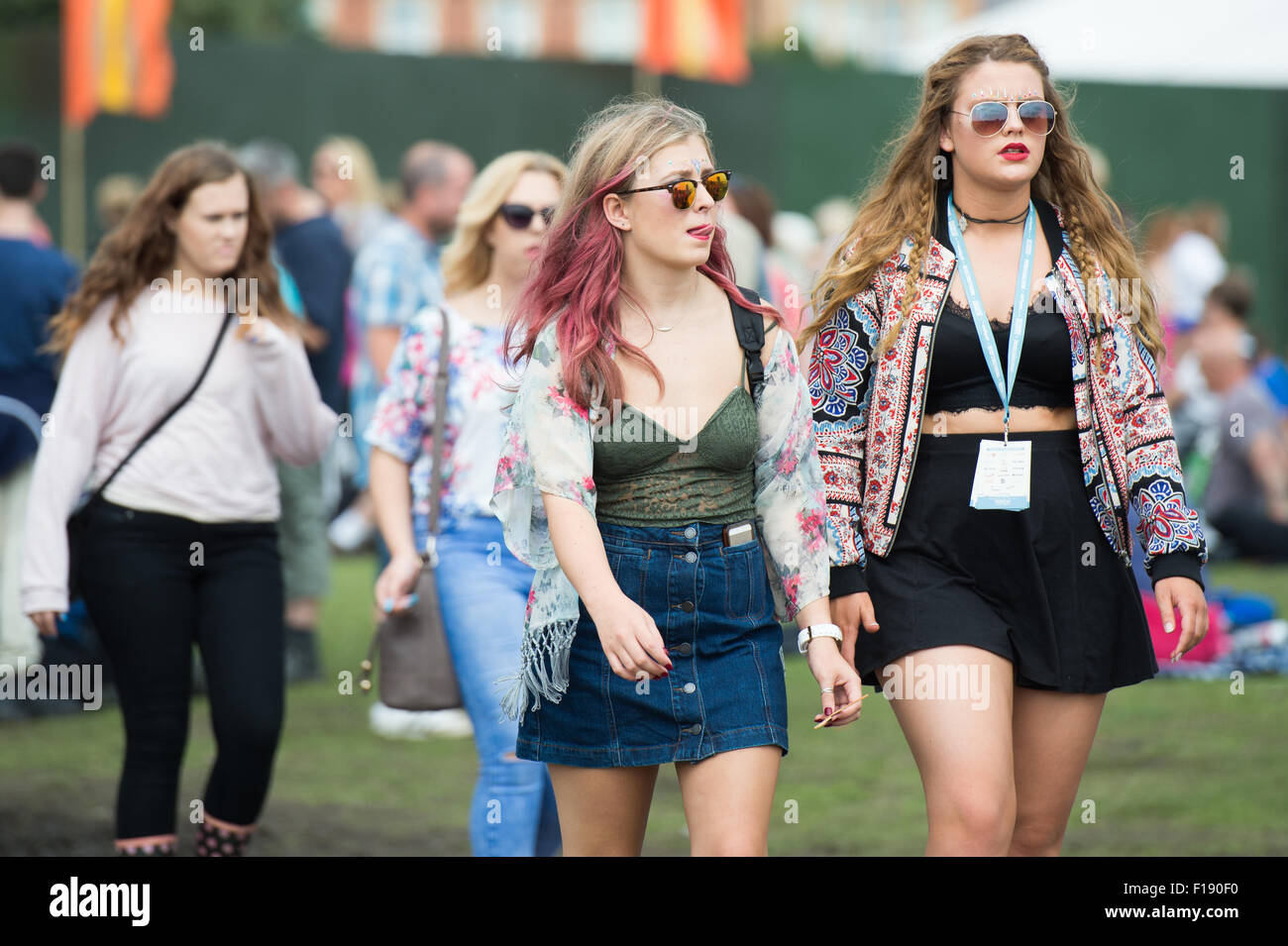 Portsmouth, UK. 30th August 2015. Victorious Festival - Sunday. Warm sunny weather sees festival goers switch ponchos Stock Photo