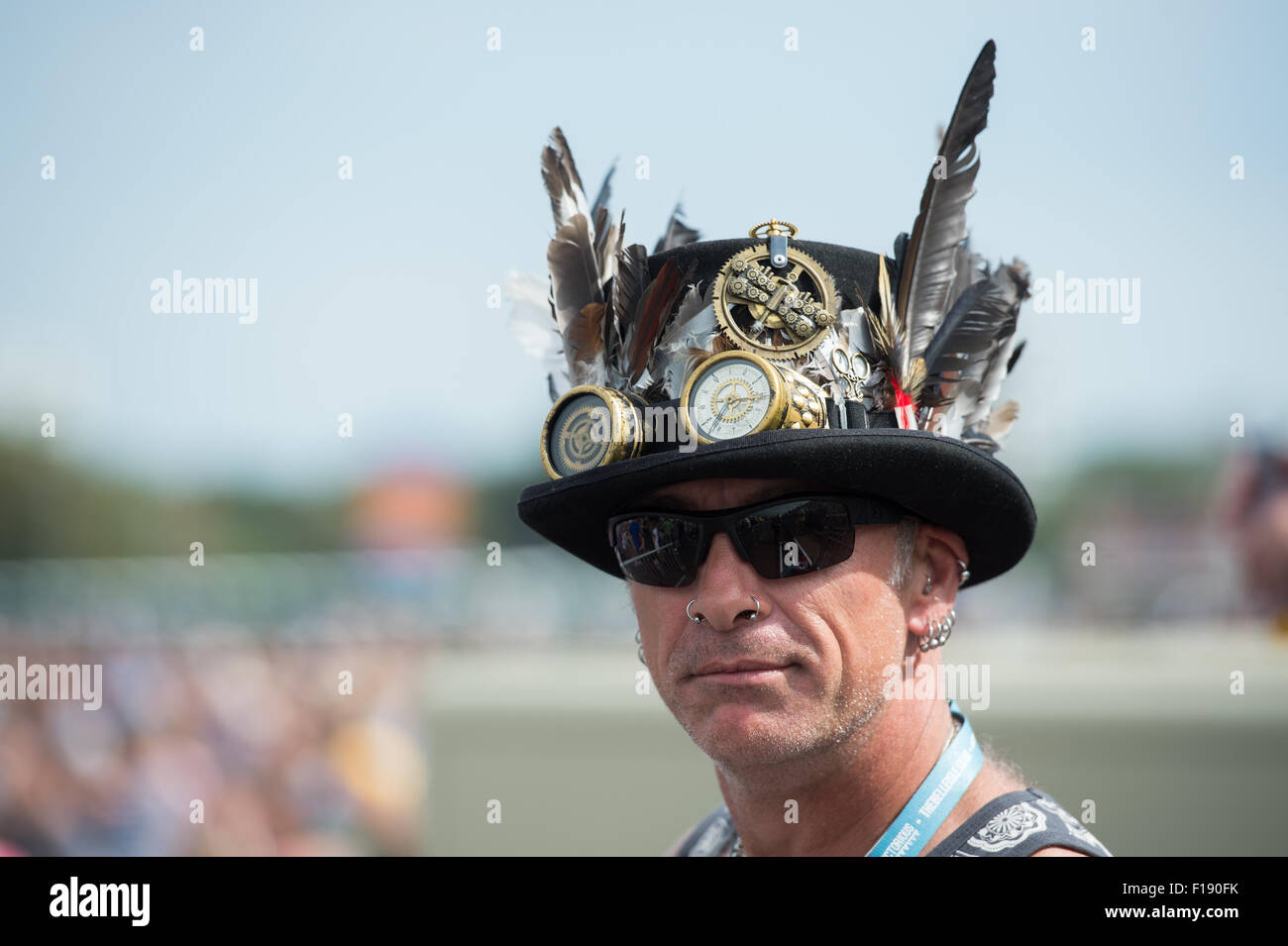 Portsmouth, UK. 29th August 2015. Victorious Festival - Saturday. A man in a steampunk hat watches Texas from the Stock Photo