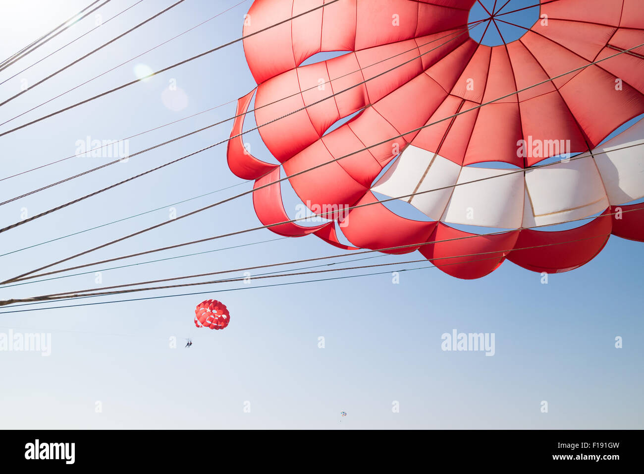 A parasailing parachute, with two other parasailers in the background - Stock Image
