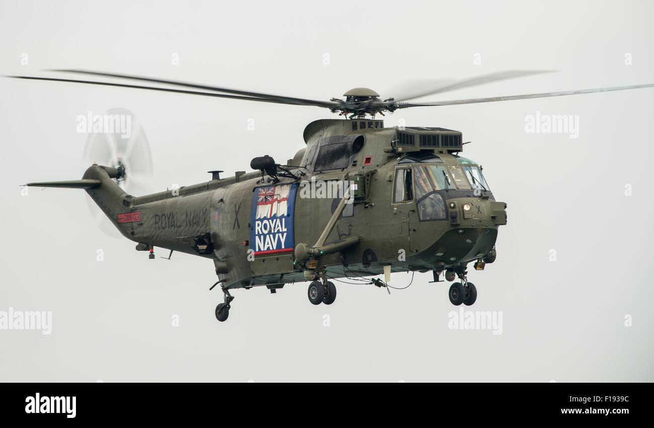 Royal Navy Sea King HC MK4 make their last appearance at Dawlish Air Show in 2015 - Stock Image