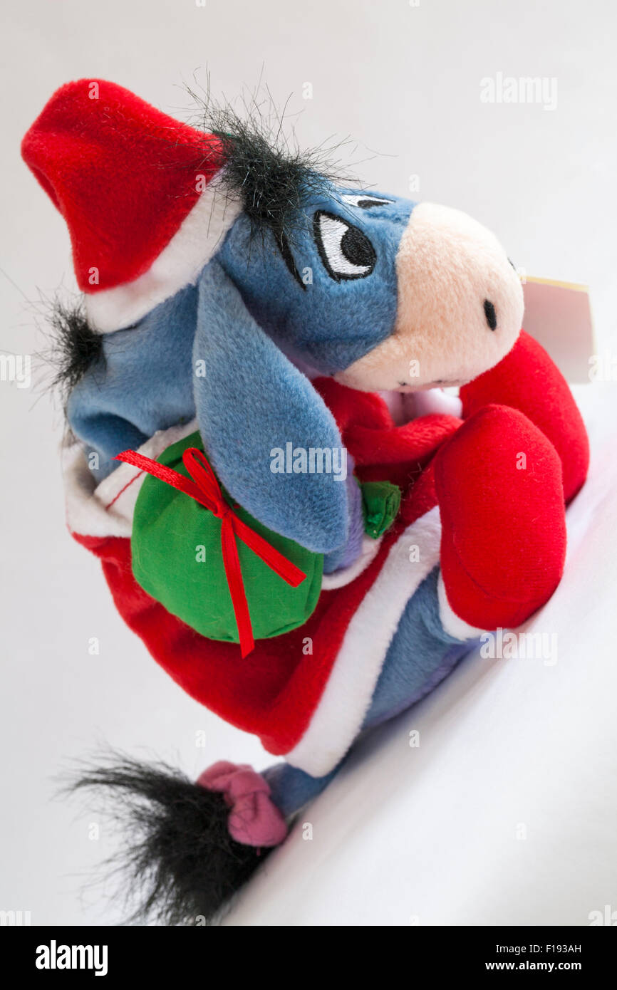 Xmas Santa Eeyore carrying sack of presents soft cuddly toy from Winnie the Pooh isolated on white background Stock Photo