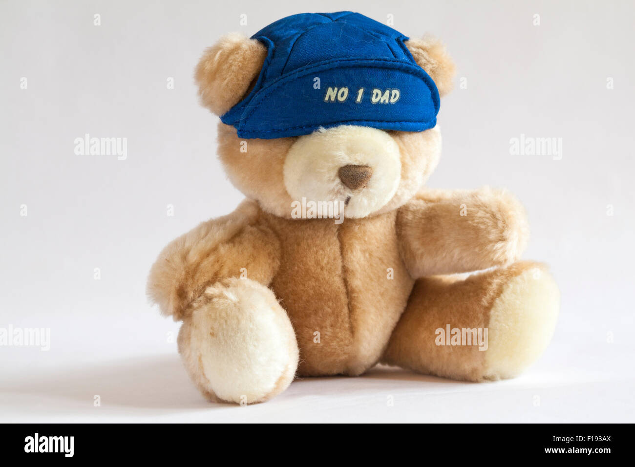 Russ Teddy bear wearing no 1 dad cap isolated on white background - ideal present for Fathers Day - Stock Image