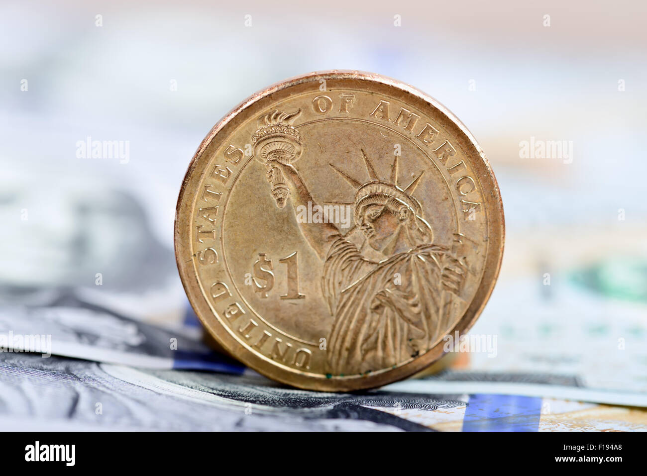 coin one dollar against the background US dollars background - Stock Image