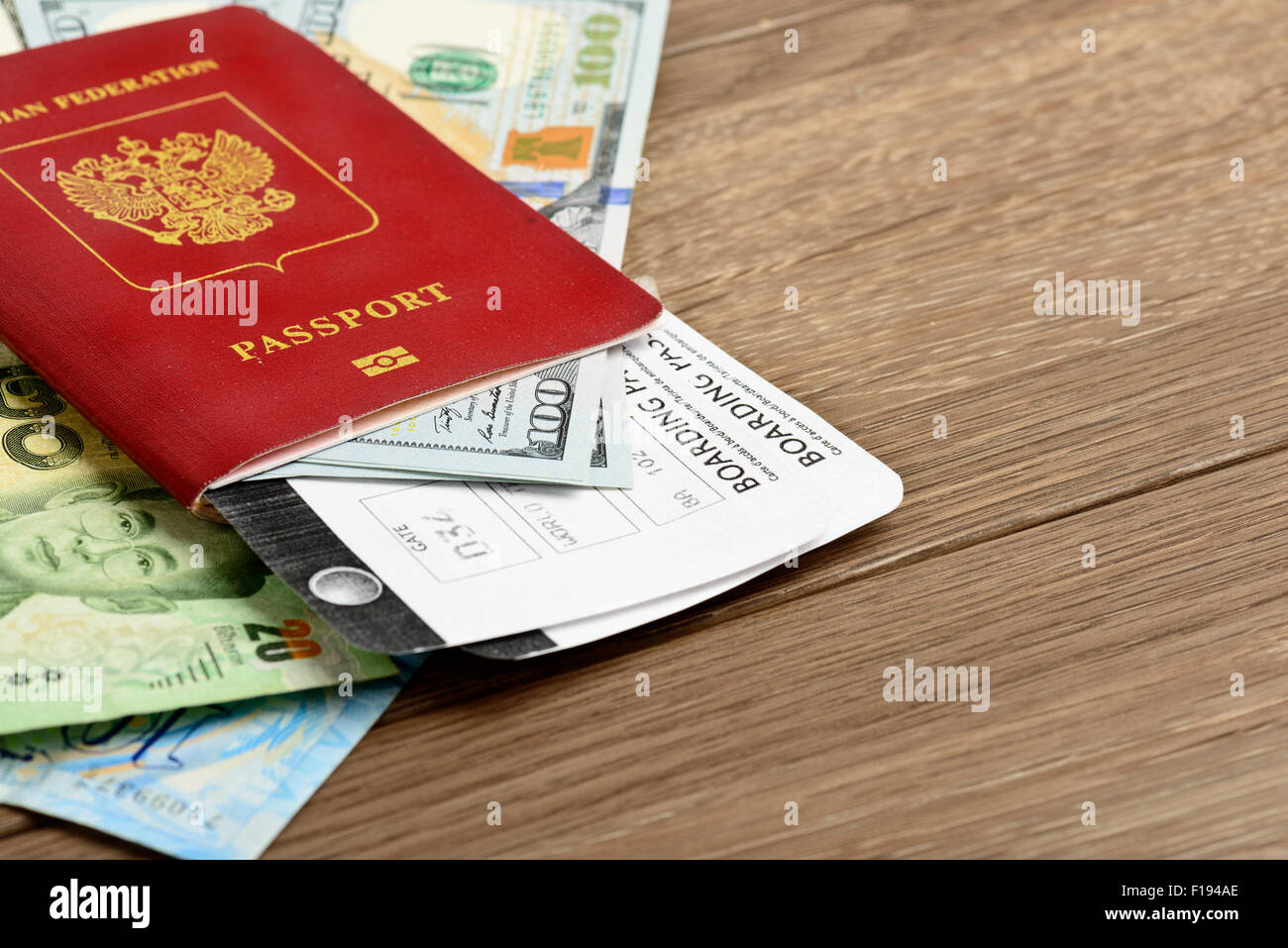 Airline tickets and documents on wooden table - Stock Image