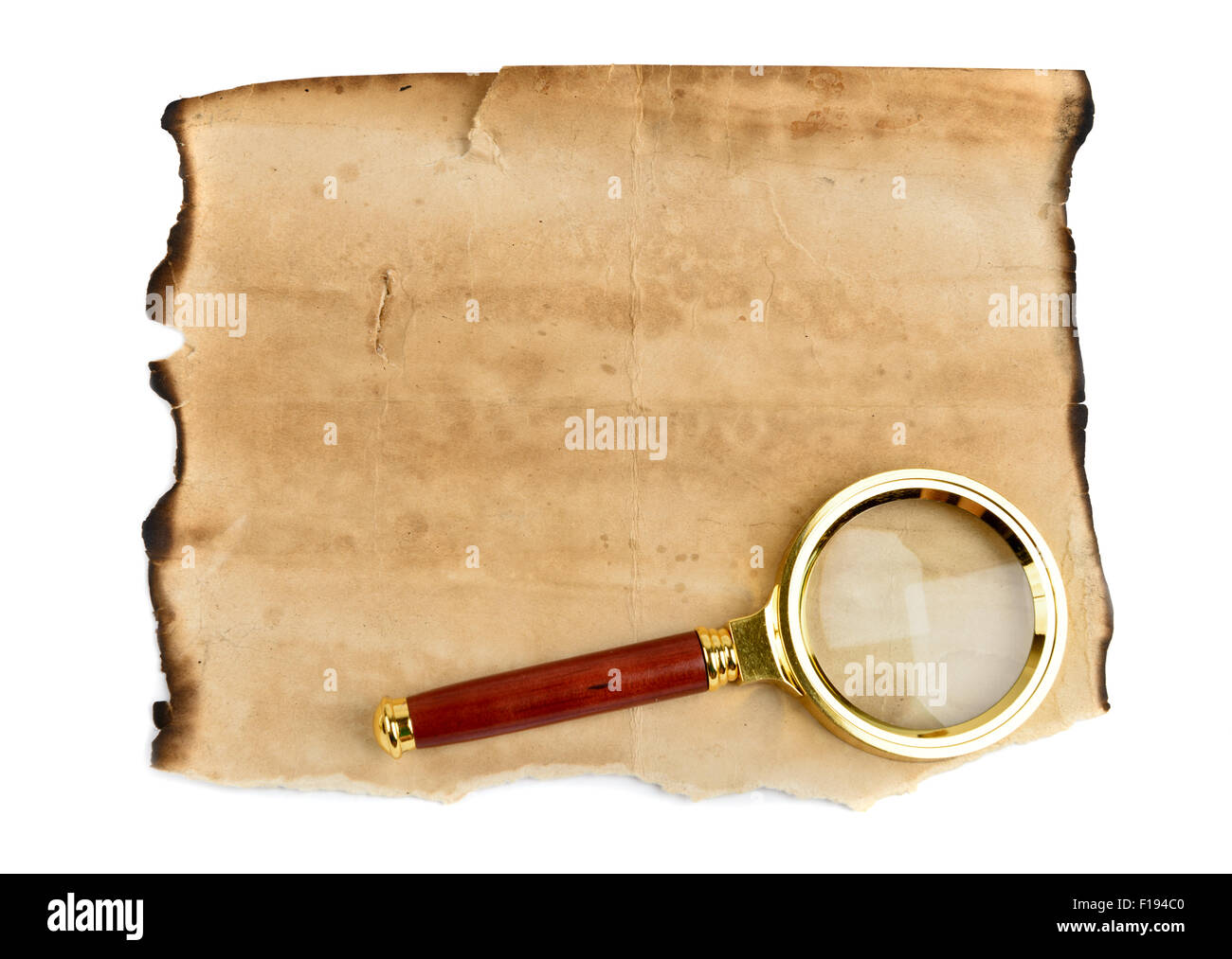 Old grunge blank paper sheet with Magnification Glass - Stock Image