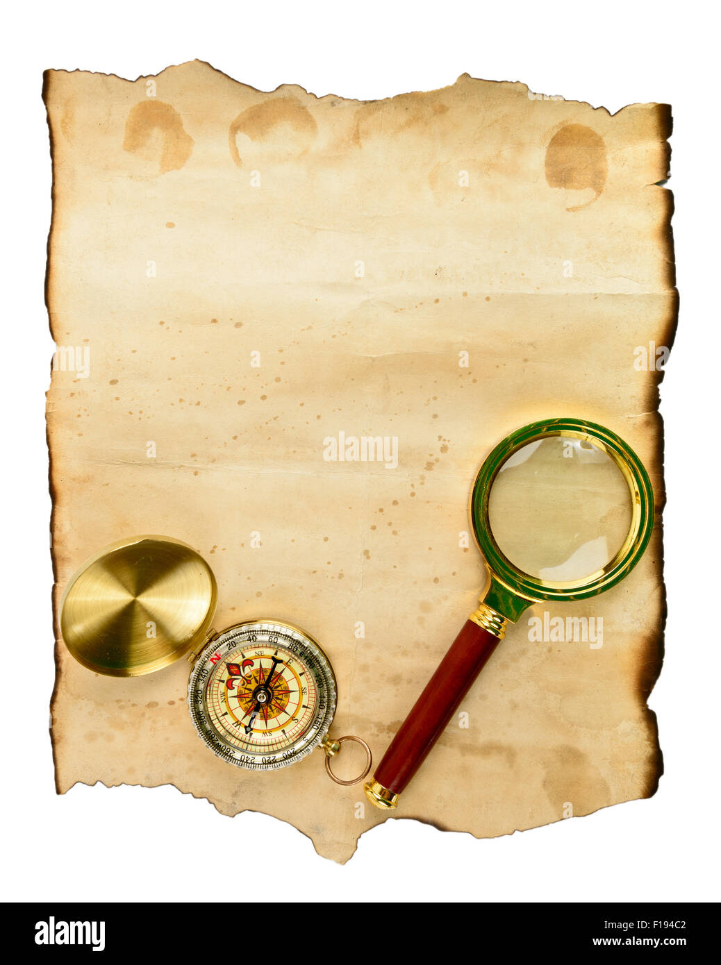 Old grunge blank paper sheet with compass and glass - Stock Image