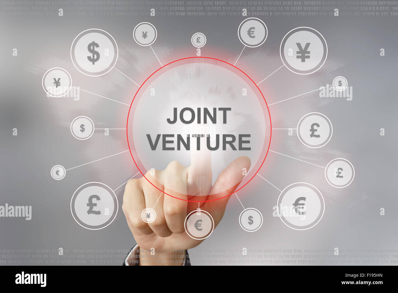 hand pushing joint venture button with global networking concept - Stock Image
