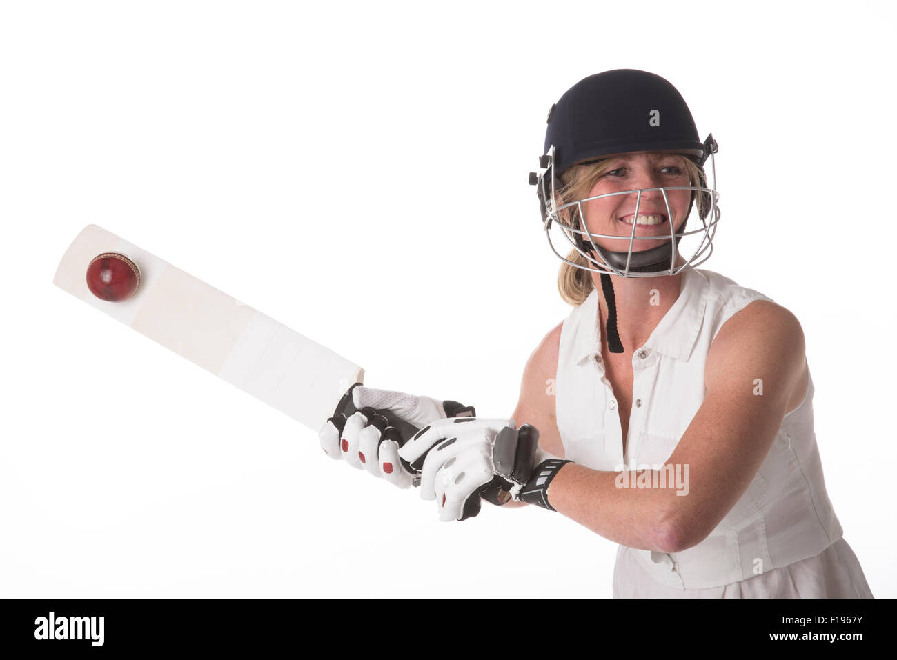 Female club cricket player hitting cricket ball with a bat cricket Stock Photo