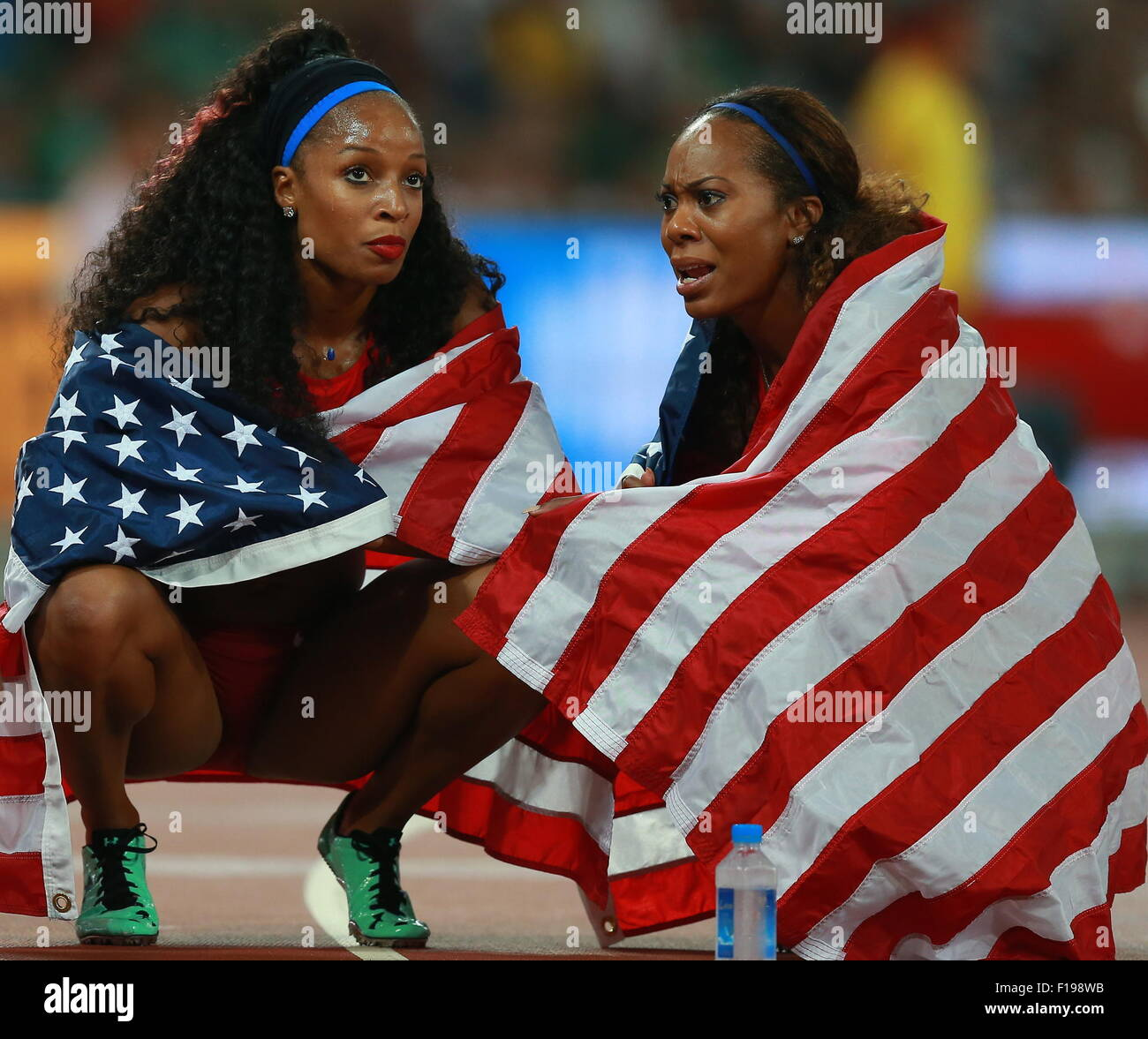 BEIJING, CHINA. AUGUST 30, 2015. Silver medalists, US Natasha Hastings (L) and Allyson Felix seen after the women's - Stock Image