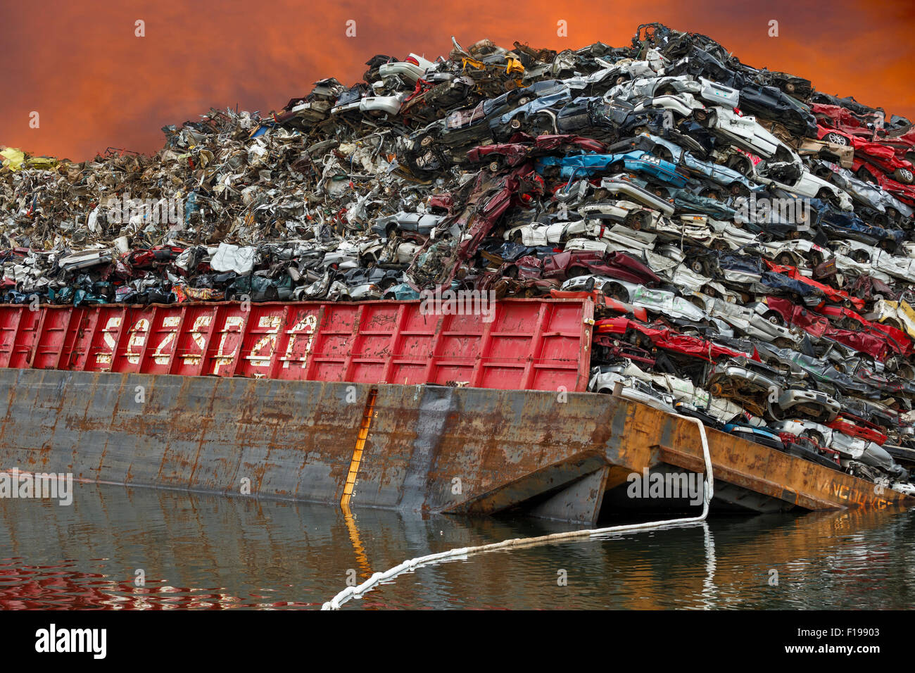Capsized barge with crushed automobiles in Gorge Waterway-Victoria, British Columbia, Canada. Note-Digital composite. - Stock Image