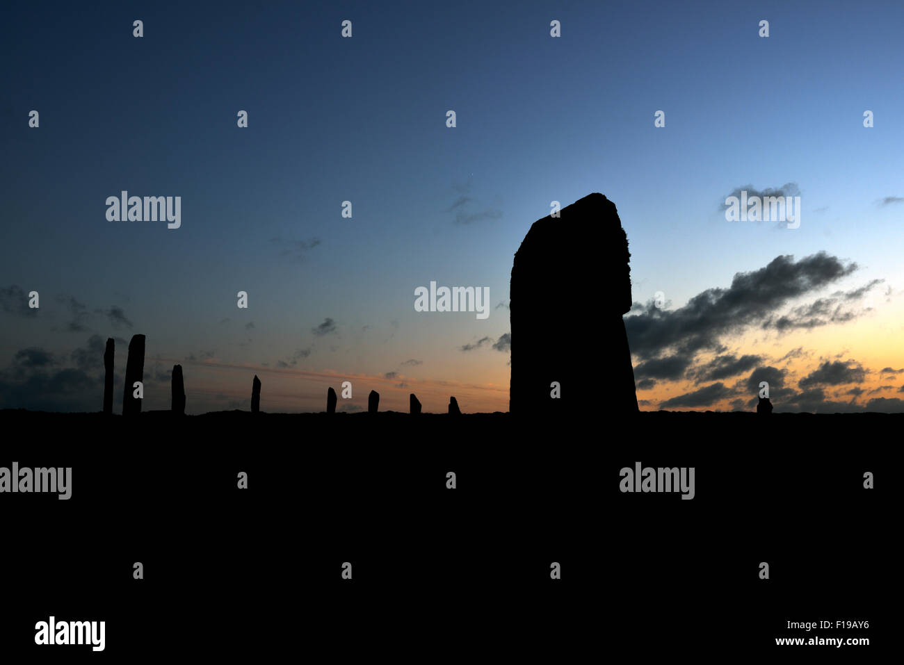 Neolithic standing stones in silhouette, Ring of Brodgar, Mainland Orkney, Scotland, UK Stock Photo